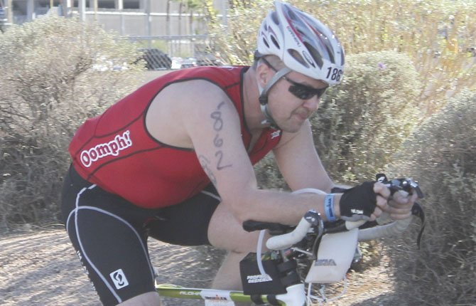 Christopher Alfson swiftly pedals up a hill at Ironman Arizona in Tempe, Ariz. The 1990 The Dalles High School graduate finished this event in seven hours and 10.41 minutes.
