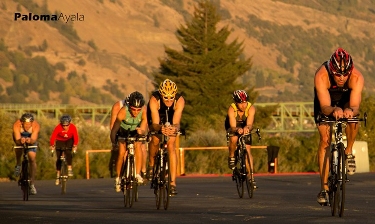 Columbia Gorge Tri Club competitors ride around the waterfront.