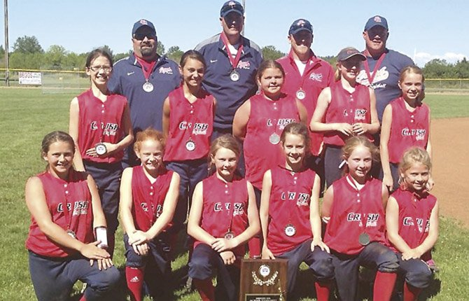 THE CHERRY City Crush 10U softball team is all smiles after scoring second placw at the ASA State Tournament. Pictured are (in back, from left), Coach Darin Jacobsen, Coach Leroy Tharp, Coach Ryan LeBreton and Coach Roger Hoylman. In the middle row are, Grace Schatz, Emma Bartlett, Savannah Ford, Mikayla Kelly and Alyse Wentz. In the front row are, Kilee Hoylman, Emma Smith, Rochelle Tilton, Kylan McCavic, Maddie Tharp, Zoe LeBreton.
