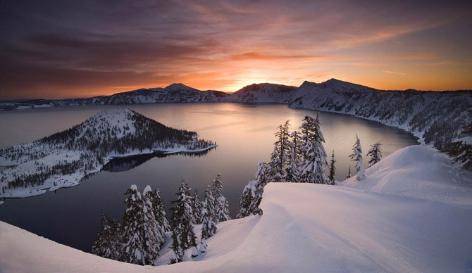 THE SUN rises over Crater Lake National Park, that may soon have insufficient water supplies for its public operations. State water regulations in the Klamath Basin have begun shutting off farmers' and ranchers' water for the first time — and could extend shutoffs to public lands including Crater Lake.