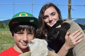 Aidan, 11 and Ellie Smith, 14, children of Barb and Dave Smith, pose with Phil (left), their pet sheep, and Louie, one of their market lambs, at their home on Post Canyon Drive in Hood River. Aidan and Ellie are involved in 4-H and Future Farmers of America, respectively, and will entries in a variety of categories for this year's Hood River County Fair, which will be held July 24-27 at the fairgrounds in Odell.