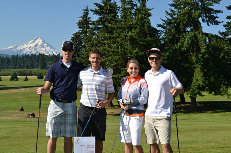 Tournament winners Josh Halemeier,Justin Kahut, Rachel Stenberg and Stephen Stenberg at Hood River Golf Course.