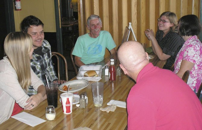 MATCH COORDINATOR COURTNEY KENDRICK (left) chats with mentors about engaging their Littles in outside activities at July's Big Social Hour, at Spooky's Pizza in The Dalles. The Big Social Hours are held every quarter, alternating locations between Hood River, The Dalles and White Salmon.