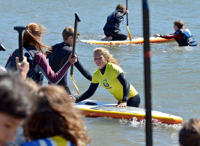 SUP4Water Awareness organizer Fiona Wylde teaches standup paddling Monday at the Waterfront Park beach.