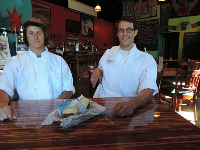 Hakujin's Colby Richards, left, and Brynden Rawdin Morris, in The Pint Shack with an example from their menu, the savory fun bun.