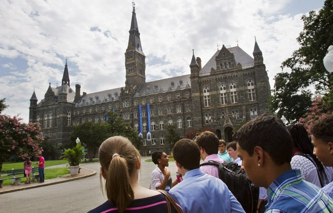 Prospective students tour Georgetown University's campus in Washington, July 10. Grants and scholarships are taking a leading role in paying college bills, according to a report from loan giant Sallie Mae. AP Photo/Jacquelyn Martin, File