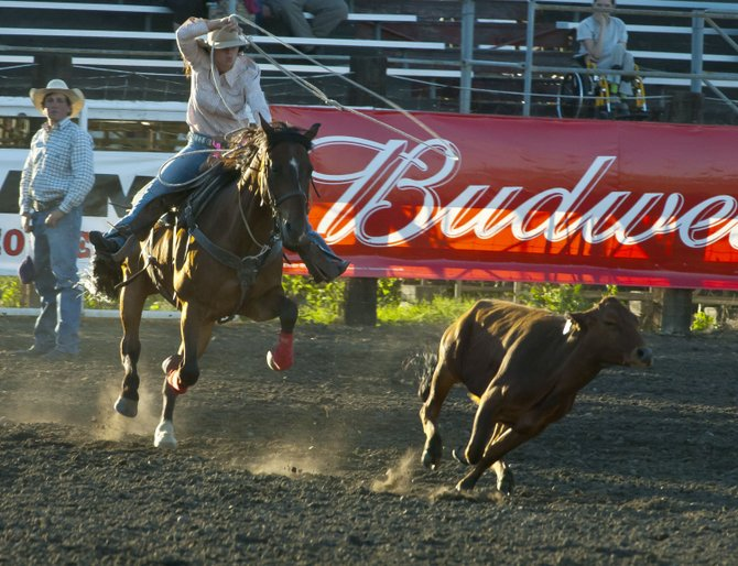 Kayla Ottmar of Benton City, Washington competes in breakaway roping during slack competion for the Fort Dalles Rough and Wild Rodeo Wednesday night at Milt Tumilson Arena. In the final standings, Michele Lyons, from her Thursday round, scored first-place honors with a time of 2.2 seconds.                                           Mark B. Gibson photo