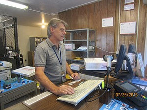 Dave McAlister, Odell Postmaster has enjoyed his work with the Postal Service for 15 years.  Commemorative stamps and post office boxes are part of his daily routine.