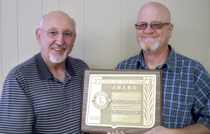 JIM BISHOP, left, presents Mike Kilkenny with the 2012-2013 Lion of the Year Award for The Dalles Lions Club.	Contributed photo