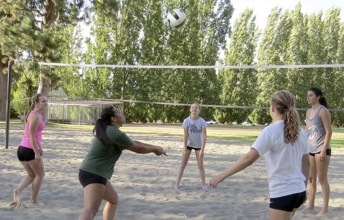 CHERRY CITY JUNIORS traveling volleyball team members practice Monday, July 29, on the sand court at Sorosis Park. They are preparing to compete in the 32nd annual Seaside Beach Volleyball Tournament Aug. 9-11. Pictured from left, are, Keaton Logue, Natalie Moleli, Lindsi Logue, Sydney Reed an Lori Cimmiyotti.