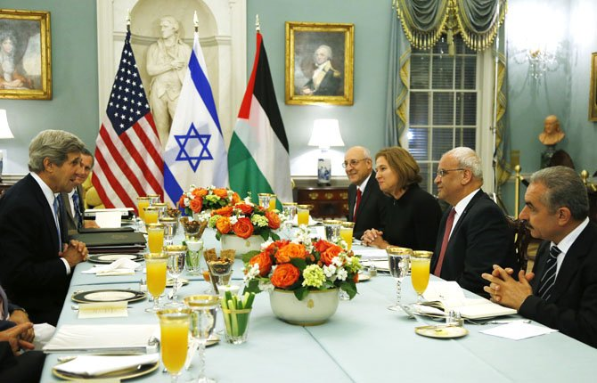 Secretary of State John Kerry, left, sits across from Israel's Justice Minister Tzipi Livni, third right, Palestinian chief negotiator Saeb Erekat, second right, Yitzhak Molcho, an adviser to Israeli Prime Minister Benjamin Netanyahu, fourth right, and Mohammed Shtayyeh, aide to Palestinian President Mahmoud Abbas, right, at an Iftar dinner, which celebrates Ramadan, at the State Department in Washington, marking the resumption of Israeli-Palestinian peace talks, July 29.