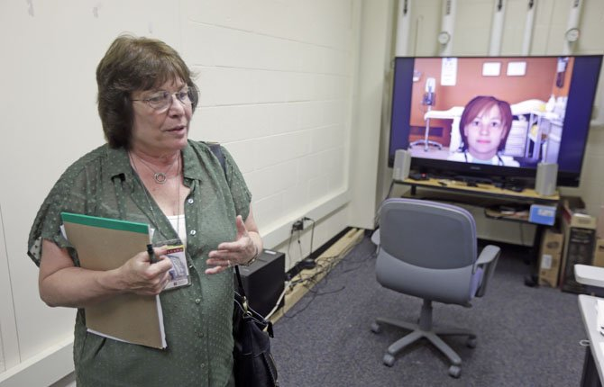 Nadine Martin, a communication sciences professor speaks in view of an avatar on a television screen during an interview with the Associated Press July 18 at Temple University in Philadelphia.