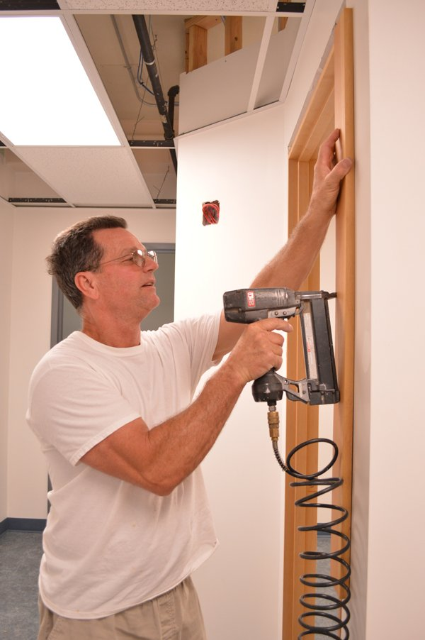 Bill Turner of Bill Turner Construction Company in Hood River puts the finishing touches on a door frame inside what will soon be the new healthcare facility in Odell.