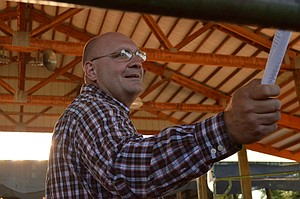 Sold!: Brent Ochesky, of Hood River, spots a bidder during the fair's 4-H and FFA market animal auction on Friday.