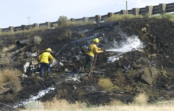Crews mop up the west end of a second alarm grass fire at Interstate 84 exit 84 westbound, between the freeway and First Street west of Union Street. The fire burned an area approximately 50 by 100 feet. Crews extinguished the fire, checked fuel tanks at nearby Hattenhauers Distributors and cleared a hand line along the east end of the fire. Cause of the fire remains under investigation.