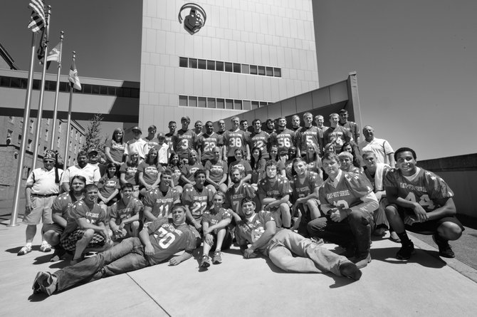 SHRINE EAST-WEST All-Star Football players and coaches for 2013 pose in front of the Shrine Hospital for Children in Portland, which is the beneficiary of this fundraising event in Baker City.