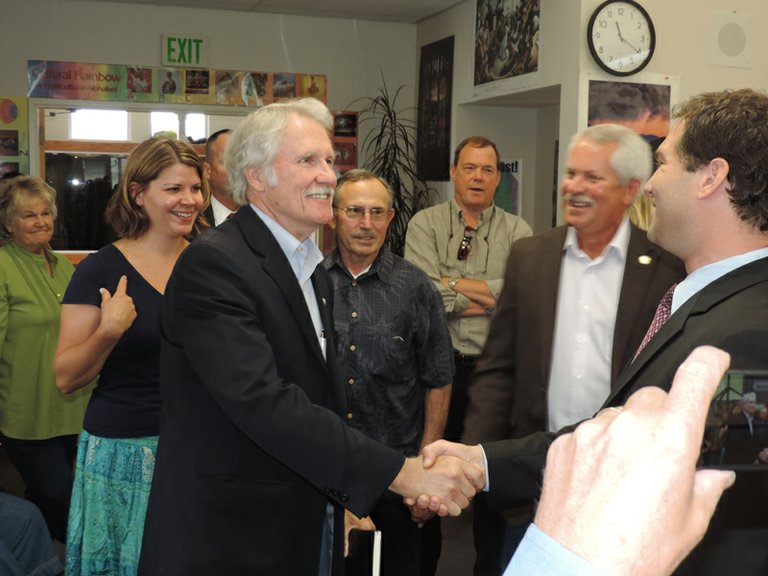 Photo by Kirby Neumann-Rea.Gov. John Kitzhaber meets Dan Goldman, superintendent of schools, right, as he arrives at Hood River Middle School library for Wednesday's round table. Looking on at right is Rep. Mark Johnson. Behind Kitzhaber, from left are Amy Wojcicki, deputy communications director for the governor, Rob Brostoff of Cascade Locks, and County Administrator Dave Meriwether.