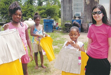 Cheree LaPierre (far right) hand delivered brand new school uniforms to some of the children she worked with this summer at the Children's Center in Jonestown, Miss.