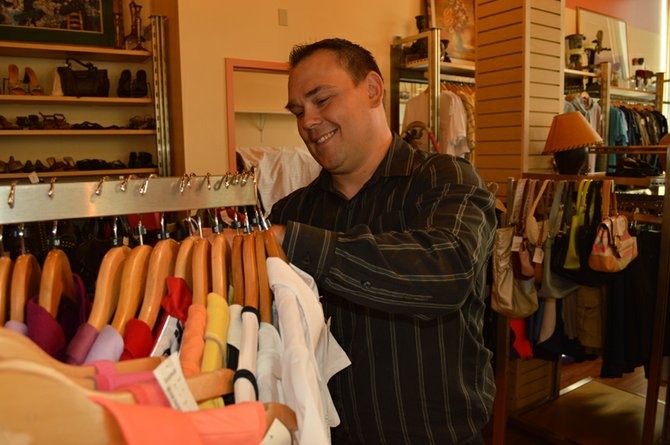 MANAGEMENT TRAINEE Michael Hendricksen will be learning the ropes at Goodwill on Oak before moving to the larger store in The Dalles later this year. He was recently laid off from the Bonneville Power Administration. Below, garments on racks await shoppers at the new Goodwill on Oak store, 304 Oak St.