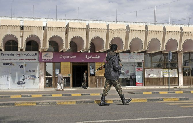 A policeman walks as he secures the Sanaa International Airport, in Yemen, Aug. 7, The State Department on Tuesday ordered non-essential personnel at the U.S. Embassy in Yemen to leave the country after intelligence indicated a strong possibility of a terror attack.