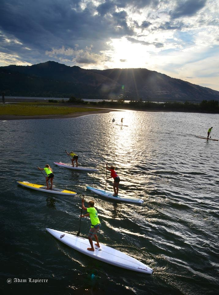 Sunrise on the water: Big Winds' youth SUP team practices Thursday morning as the sun climbs over the hills beyond. The team of 30 teenagers is training hard to get ready for next weekend's Naish Columbia Gorge Paddle Challenge. See the August 10 Hood River News for the story.