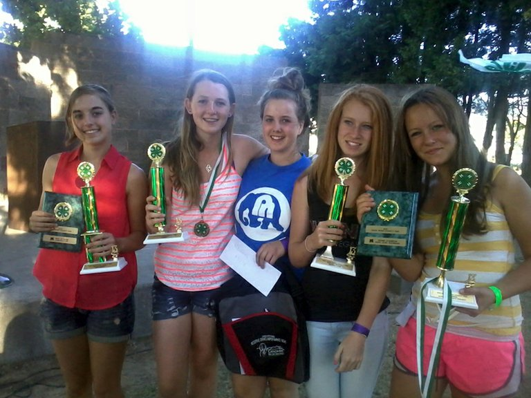 PARKDALE HOOD HOPPERS with their awards from the 4-H barbeque at the Hood River County Fair. From left are Sara Zeman, Megan Ball, Madison Mooney, Kayla Green and Angela Bruggeman. Rachael Mooney received a trophy but is not pictured.
