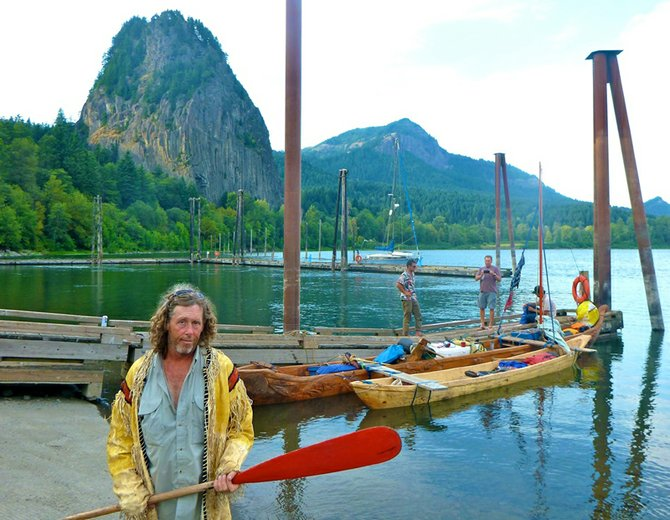 CANOE builder Churchill Clark rests at the Beacon Rock marina Thursday en route east to Hood River. Clark and companion, will show a documentary on Voyages of Rediscovery 11 a.m. Monday at the History Museum of Hood River County.