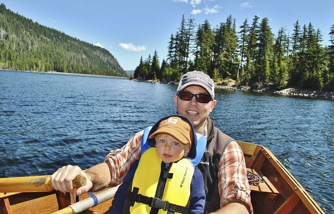 Ryland Moore teaches his son Bennett how to row a drift boat on Laurence Lake.	Contributed photo