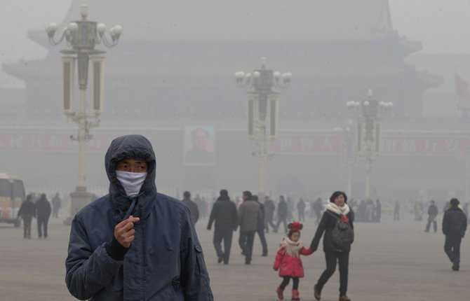 A man wears a mask on Tiananmen Square earlier this year in thick haze in Beijing. China, one of the most visited countries in the world, has seen sharply fewer tourists this year, with worsening air pollution partly to blame. 		