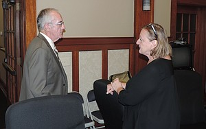 Don Otterman talks with acting city manager Cindy Waldbridge at the Aug. 12, 2013 Hood River City Council meeting.
