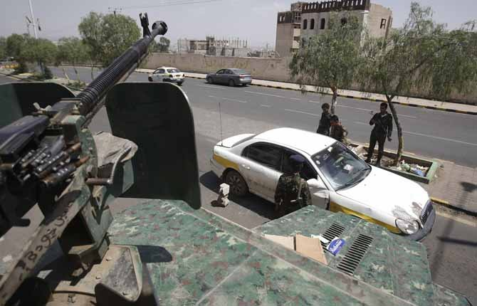 FILE - This Aug. 10, 2013 file photo shows Yemeni soldiers inspecting a car at a checkpoint on a street leading to the U.S. and British embassies in Sanaa, Yemen. In secretive chat rooms and on encrypted Internet message boards, al-Qaida fighters have been planning and coordinating attacks _ including a threatened if vague plot that U.S. intelligence officials say closed 19 embassies across Africa and the Middle East for more than a week. (AP Photo/Hani Mohammed, File)