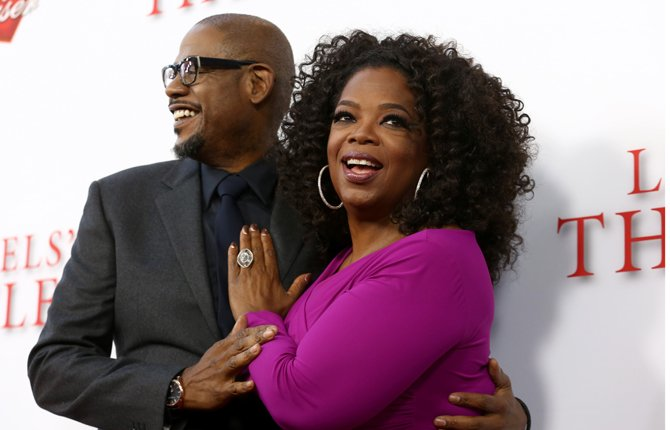 "Forest Whitaker, left, and Oprah Winfrey arrive at the premiere of ""Lee Daniels' The Butler"" in Los Angeles. The film opens nationwide on Friday. 