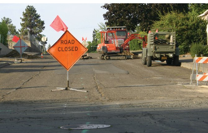 "A ""Road Closed"" sign marks construction on Bridge Street, one of numerous city streets in need of repaving. Bridge and related side streets south of 14th Street have already been repaired. The City of The Dalles and the Wasco County Board of Commissioners have planned a joint meeting Monday, Aug. 19 at noon in City Hall to discuss possible joint solutions for funding needed road work.