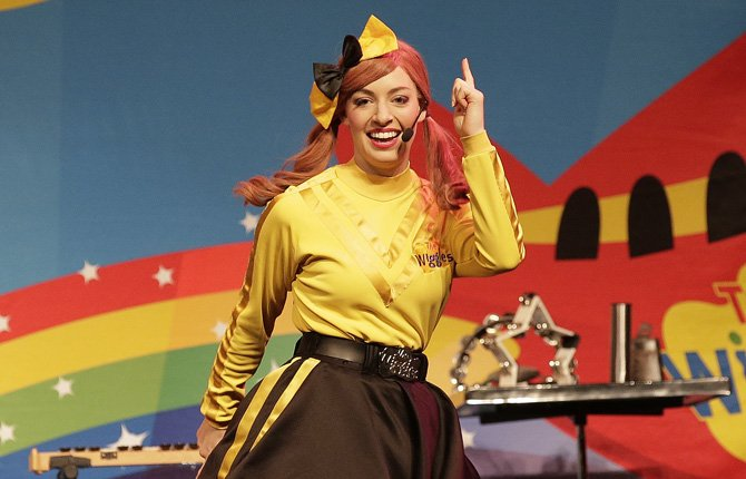The Wiggles' Emma dances and sings during a performance in Canberra, Australia. She is the first woman to join the children's entertainment group.