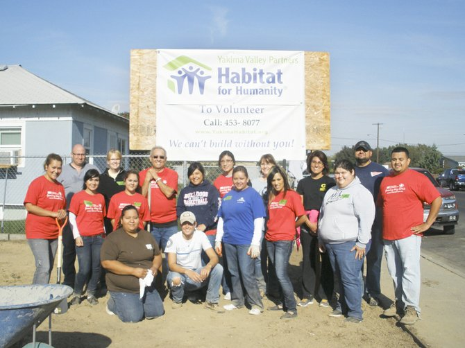 Assisting with Habitat for Humanity projects is just one of the efforts that earned AmeriCorps members in the Community HealthCorps at Yakima Valley Farm Workers Clinic a Daily Point of Light Award.