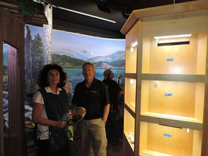 DIORAMA ARTIST Peggy O'Neal and chief designer Larry Watson of Kow-Kwow Arts and Exhibits..