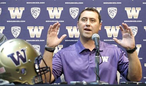 Washington head coach Steve Sarkisian talks during a news conference about his football team Monday, Aug. 5, 2013, in Seattle. Washington begins practice Monday afternoon.