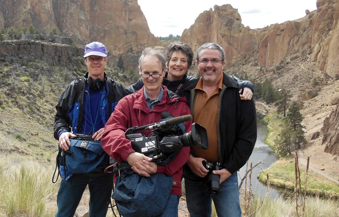 "ARTIST CAMERON KASEBERG, right, poses with crew members of Oregon Public Broadcasting's ""Oregon Art Beat"" during filming in Central Oregon. Crew members pictured from left, Ted Cutler, audio technician; Tom Shrider, videographer-editor, Katrina Sarson, co-host-producer. 	 Contributed photo"