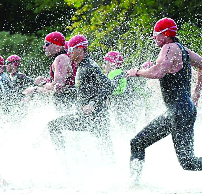Participants in the Aluminum Man Triathlon and Duathlon shred through the waters for one phase of three in last year's run at Riverfront Park in The Dalles. More than 200 long-distance athletes will converge to The Dalles for the 25th annual event starting at 9 a.m. on Saturday, Sept. 7.