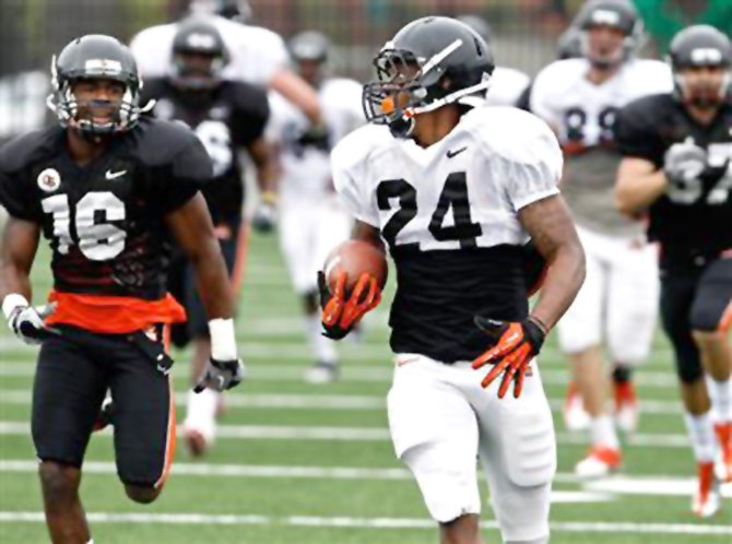 Storm Woods' long touchdown run highlights Oregon State's first spring scrimmage earlier this summer in Corvallis. With Woods and teammate Terron Ward, the Beavers start the 2013 season with a potent 1-2 punch at the running back position.