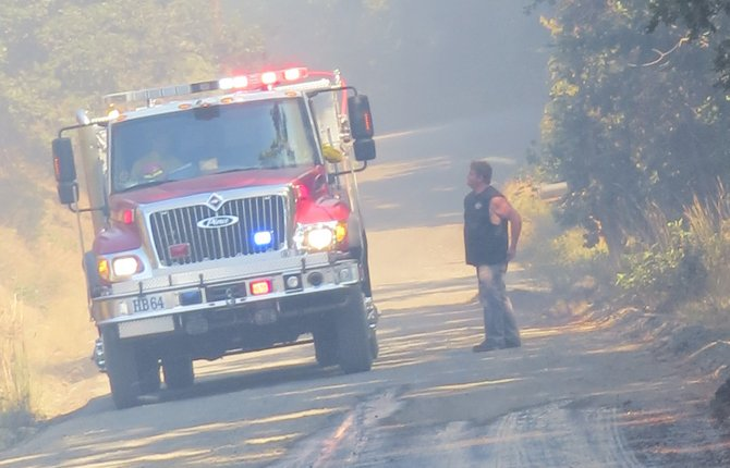 A Mill Creek area resident asks firefighters for information