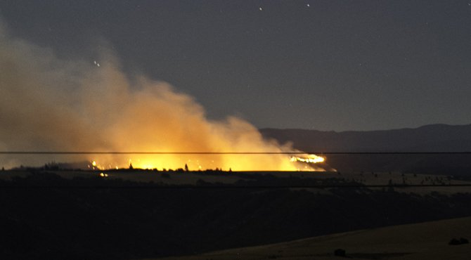 Flames show starkly against the dark in one of the Government Flat complex fires, as viewed from Sevenmile Hill.