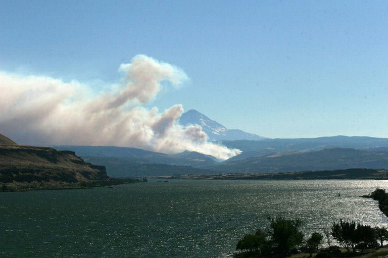 smoke erupts from a lightning-caused fire burning near The Dalles.The fire was declared a state conflagration Saturday evening by Gov. John Kitzhaber.