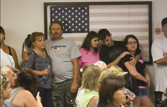 RESIDENTS CROWDED into the meeting room at Mid-Columbia Fire and Rescue Tuesday, Aug. 20, lining the walls and spilling out into the lobby to hear an update on the Government Flats Fire Complex.