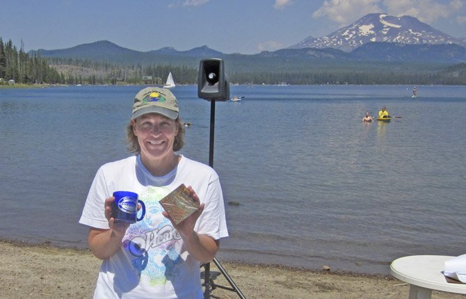 THE DALLES' Ann Goodman shows off her awards after competing in the 19th annual Cascade Lake Swim Series at Elk Lake on Aug. 4.