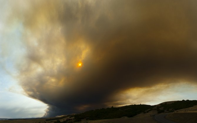 SHIFTING WINDS spread the Blackburn Fire toward the north and west Aug. 21 and scattered ash as far away as Parkdale.