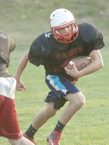 DUFUR'S Trever Tibbets glides through a hole for a long run in Tuesday's practice. With a stable of weapons on offense, the Rangers are looking to put up more than the 427 points scored last year.