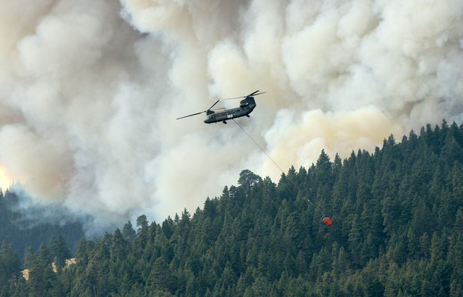 An Oregon National Guard helicopter attacks the Blackburn Fire.