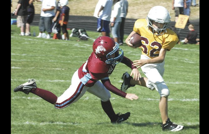 PLAYERS from the Gorge Youth Football League hit the field in tackle football action last season at Sid White Field in The Dalles. Starting at 9 a.m. and going until 2 p.m. Saturday at Columbia High School in White Salmon, Wash. teams from across the region will take part in their annual jamboree showcase.