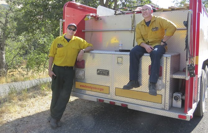 Brad Shinpaugh and Steve Black stand watch over the Blackburn fire.